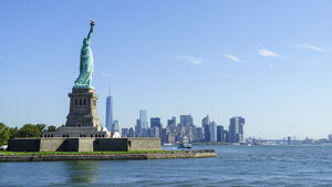 Statue of Liberty and Liberty Island with Manhattan skyline in view, New York City