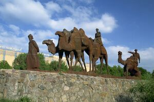 Statues of camels and camel drivers on Silk Road monument