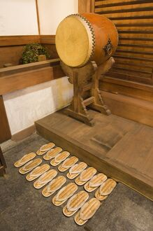 Straw sandals and drum at temple
