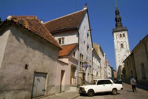 Street scene and the Niguliste Church tower, in the Old Town, Tallinn, Estonia