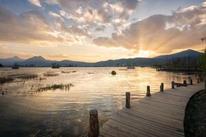sunset mountains lake boardwalk lijiang yunnan