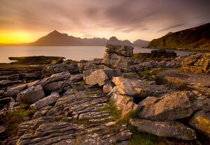 Sunset view over rocky foreshore to the Cuillin Hills from Elgol, Isle of Skye