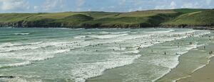 Surfers at Polzeath, Hayle Bay and the Cornish coast, Cornwall, England