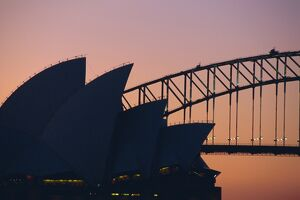 Sydney Opera House and Harbour Bridge silhouetted together at sunset, Sydney