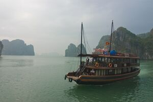 Tourist boat in a traditional style cruising the Halong Bay, Vietnam, Indochina