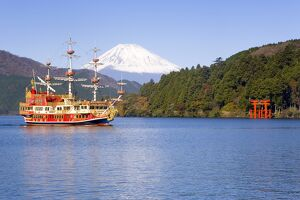 Tourist pleasure boat on lake Ashino-ko with the red