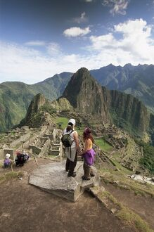 Tourists looking out over the ruins of the Inca site