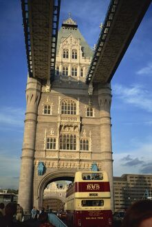 Detail of Tower Bridge, with double-decker bus passing through, London