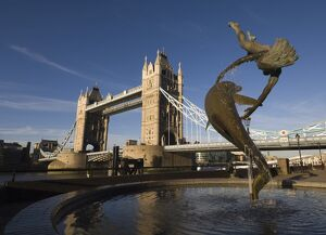 Tower Bridge and the Girl with a Dolphin sculpture, River Thames, London, England
