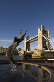 Tower Bridge and Girl with a Dolphin statue, River Thames, London, England