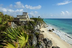 Tulum beach and El Castillo temple at ancient Mayan site of Tulum, Tulum