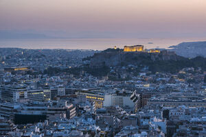 View over Athens and The Acropolis at sunset from Likavitos Hill, Athens, Attica Region