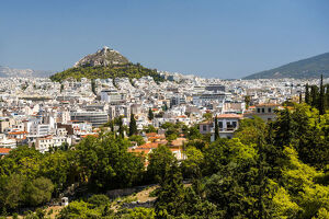 View of Athens and Likavitos Hill over the rooftops of the Plaka District from The