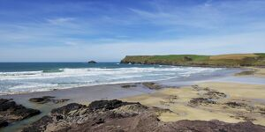 View of Atlantic surf at Polzeath beach, looking north to Pentire Headland