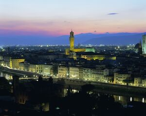 View over city at night from Piazzale Michelangelo
