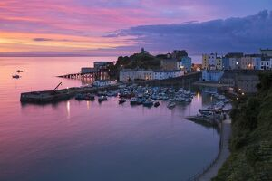 View over harbour and castle at dawn, Tenby, Carmarthen Bay, Pembrokeshire, Wales