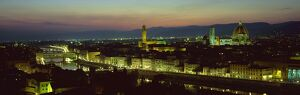 View at night over rooftops of Florence, showing Duomo, Uffizi and Ponte Vecchio