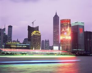 View across river at dusk to the new Pudong district skyline, Huangpu River