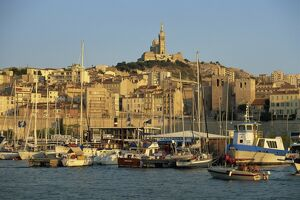 View across the Vieux Port to the basilica of Notre Dame de la Garde, Marseille