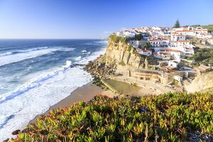 Top view of the village of Azenhas do Mar with the ocean waves crashing on the cliffs