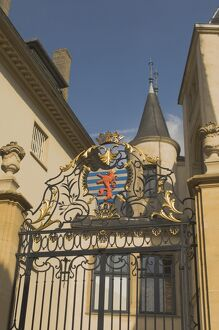 Wrought iron gate with coat of arms