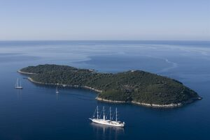 Yacht sailing round the island of Lokrum, part of the Elaphite Islands