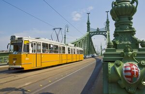 Yellow tram on The Liberty Bridge (Szabadsag hid), over the Rver Danube