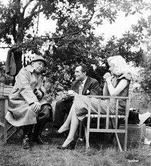 AE Matthews, Patrick Holt, and Diana Dors on the set of Leslie Arliss' Miss Tulip