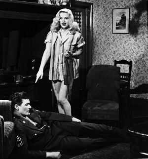 Diana Dors and Dominic Roche in Maurice Elvey's My Wife's Lodger (1952)