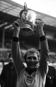 League Cup Final, Wolves vs Manchester City, Captain Mike Bailey holds aloft the trophy