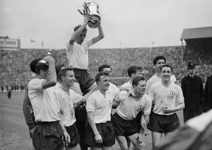 Danny Blanchflower celebrates with his teammates after Tottenham win the FA Cup in 1961