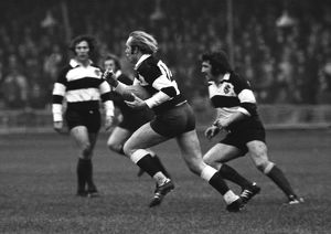 David Duckham runs with the ball for the Barbarians against the All Blacks in 1973
