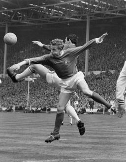 Denis Law and Gordon Banks clash during the 1963 FA Cup Final