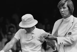 Doris Hart helps the injured Nancy Richey from the court - 1970 Wightman Cup