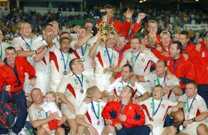 The England team celebrate after winning the rugby World Cup