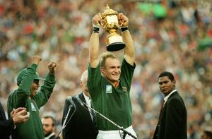 Francois Pienaar lifts the World Cup for South Africa as Nelson Mandela cheers