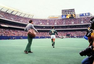 football/franz beckenbauer runs giants stadium peles farewell