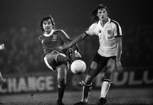 George Best passes the ball as he is challenged by Glenn Hoddle