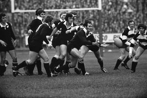Ian Kirkpatrick passes the ball out for the All Blacks against the Barbarians in 1973