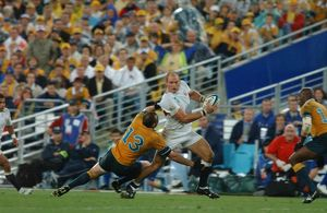 Lawrence Dallaglio runs with the ball during the build-up to England's try in