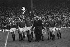The Manchester United team do a lap of honour with manager Matt Busby after winning