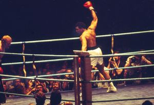 Muhammad Ali show off to the crowd as he knocks down Richard Dunn