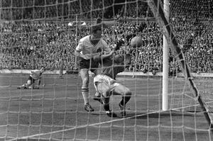 Nat Lofthouse controversially collides with goalkeeper Harry Gregg for his second