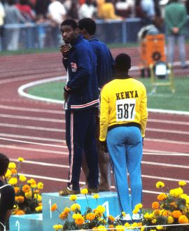 Olympic 400m winner Vince Matthews shows his disinterest in the medal ceremony in