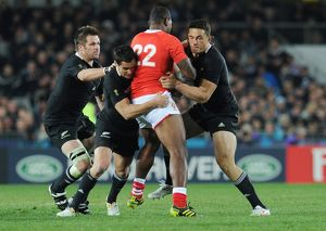 Richie McCaw, Dan Carter, and Sonny Bill Williams make a tackle at the 2011 Rugby