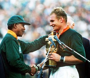 South Africa captain Francois Pienaar receives the World Cup from Nelson Mandela in 1995