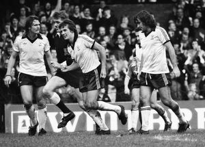 Terry Bullivant celebrates a goal for Fulham with George Best