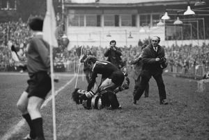 Tom David and Grant Batty fight during the famous game between the All Blacks