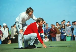 The USA's Lanny Watkins and Ed Sneed line up a putt at the 1977 Ryder Cup
