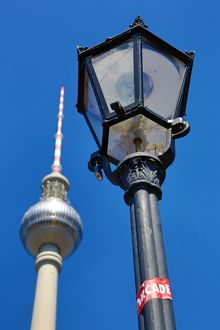Berlin TV Tower, Fernsehturm, television tower and a lamppost in Berlin, Germany